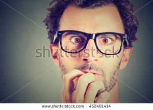 stock-photo-anxious-stressed-young-man-looking-at
