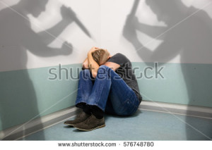 -attacking-abuse-man-sitting-at-the-corner-of-a-room-paranoia